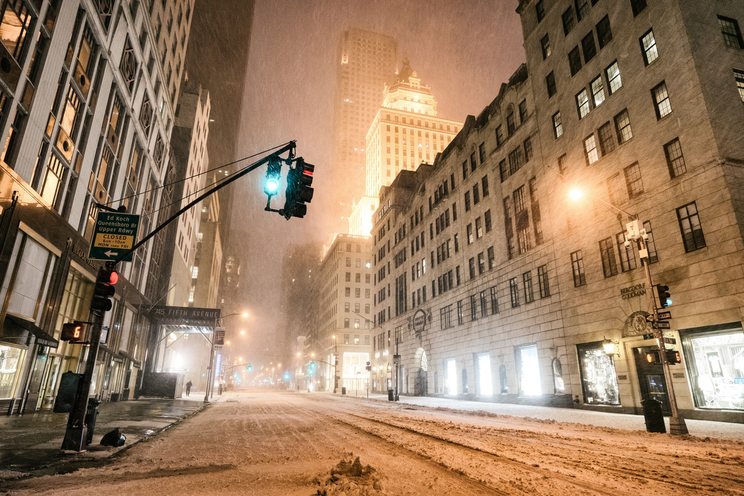 "New York City - Snow - Winter Storm Juno - Empty 5th Avenue - Bergdorf | Juno: The first snowstorm of 2015 in New York City.  ---  (Note: My <a href=""http://www.amazon.com/gp/product/1440339589/ref=as_li_tl?ie=UTF8&camp=1789&creative=9325&creativeASIN=1440339589&linkCode=as2&tag=nyththle0e-20&linkId=ER6GYT5FRYNMEPLF"" rel=""nofollow"">New York photography book</a> released worldwide in stores/online recently and has photos similar to this  [full info below])  ---  I have been photographing New York City during snowstorms at night for the past 5 years. When it comes to experiencing <a href=""http://nythroughthelens.com/tagged/snow"" rel=""nofollow"">New York City in the snow</a>, I relish the challenge. The more gusty, snowy, and brutal the storm, the more of a chance that I will be out in it traipsing around New York City with my cameras in tow.  When I heard that the MTA was suspending all transit service (and most vehicles) at 11 pm, I made the decision to take the train up to the Upper East Side prior to 11 pm to deposit myself up there with the intention of walking from the Upper East Side to Times Square and then walking the several miles back to the Lower East Side (whew!!).  The streets were eerily empty.  Emptier than they are usually at night during snowfall. Since there was a ban on all vehicles aside from snow plows and emergency services, there were practically no cars at all on the streets. Even taxis were banned from the streets!  I walked in the middle of avenues and streets that are usually teeming with cars.  There was an eerie sense of calm.  It was magical.   ---  This is part of a post that I posted to my NYC photography blog. If you are curious enough to look at the photos there, here is the link to the post:  <a href=""http://nythroughthelens.com/post/109291619025/new-york-city-snow-winter-storm-juno-i"" rel=""nofollow"">New York City - Winter Storm Juno</a>   ----  * As mentioned above - My New York City coffee table book that released in stores/online worldwide recently.   Tons of information about my <a href=""http://www.amazon.com/gp/product/1440339589/ref=as_li_tl?ie=UTF8&camp=1789&creative=9325&creativeASIN=1440339589&linkCode=as2&tag=nyththle0e-20&linkId=ER6GYT5FRYNMEPLF"" rel=""nofollow"">New York photography book</a> with sample pages (including where to order and what stores are carrying it) here:  <a href=""http://nythroughthelens.com/post/92873566010/ny-through-the-lens-the-book-i-am-super"" rel=""nofollow"">NY Through The Lens: A New York Coffee Table Book</a> ---   View my New York City photography at my website <a href=""http://nythroughthelens.com/"" rel=""nofollow"">NY Through The Lens</a>.  View my Travel photography at my travel blog: <a href=""http://travelinglens.me/"" rel=""nofollow"">Traveling Lens</a>.  Interested in my work and have questions about PR and media? Check out my:  <a href=""http://nythroughthelens.com/about"" rel=""nofollow"">About Page</a> 