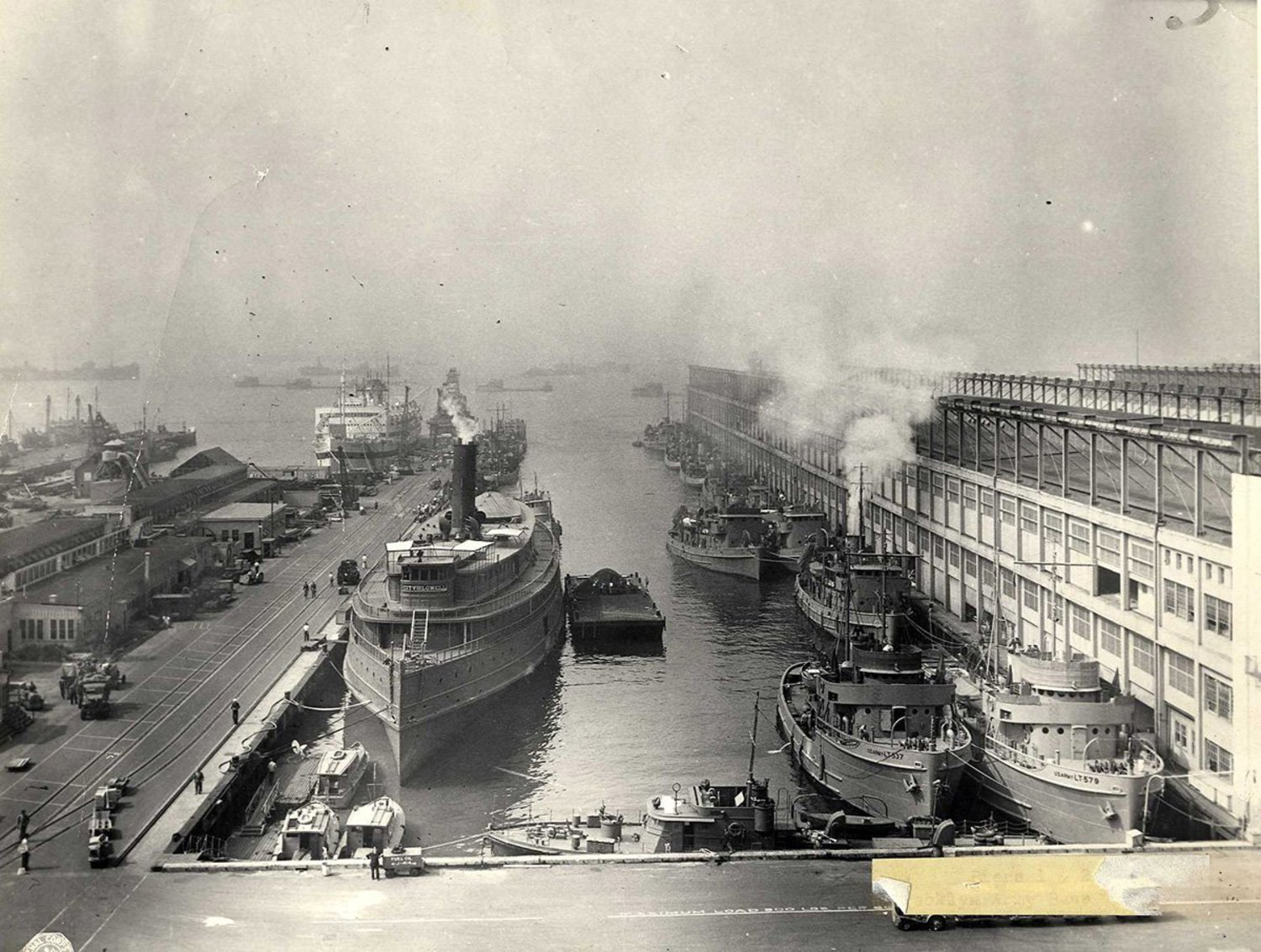 "BAT was designed as an ""inter-modal"" shipping port, meaning supplies and people could move seamlessly between trains and ships. Train tracks led directly onto piers so troops and supplies could load onto ships with minimal delay. During World War II, the Terminal was used primarily to transport supplies and house the 60,000 workers who made the port of New York run."
