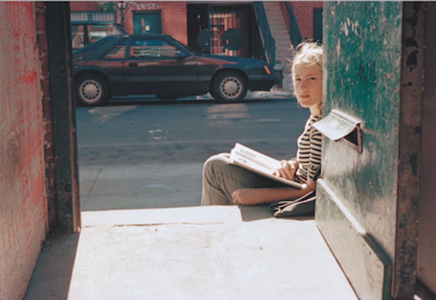 Girl Reading in Doorway of Serenity House, 1997