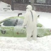 Yeti clearing snow