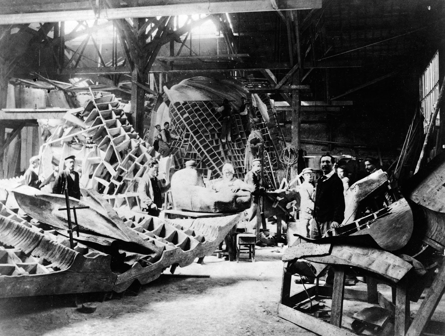 View of portions of the Statue of Liberty during its construction in the workshop of French sculptor Frederic Auguste Bartholdi (seen at left) in Paris circa 1880.