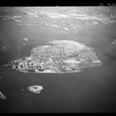 "Rikers Island | Aerial view of Rikers Island in the East River in the Bronx, New York.  <strong>Date of Original:</strong> 12-23-1957  <strong>Source:</strong> New York State Archives, Aerial photographic prints and negatives of New York State sites, 1941-1957, B1598-99.  <strong>For More Information:</strong> <a href=""http://iarchives.nysed.gov/dmsBlue/viewImageData.jsp?id=138893"" rel=""nofollow"">New York State Archives Digital Collections</a>"