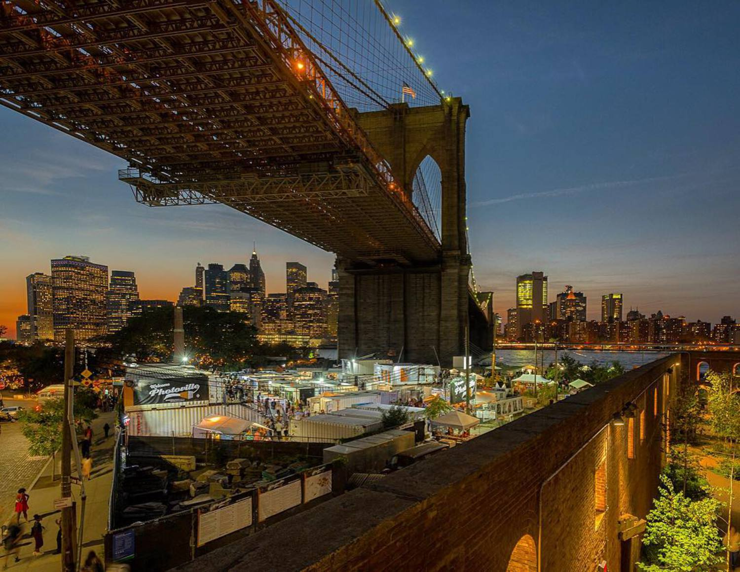 Nestled under the Brooklyn Bridge and surrounded by the Brooklyn Bridge Park – Photoville 2016 #photographyexhibition #photoville2016 #dumbo #skyline #photography #nycparks @photovillenyc @brooklynbridgepark @dumbobid @what_i_saw_in_nyc #seeyourcity #art