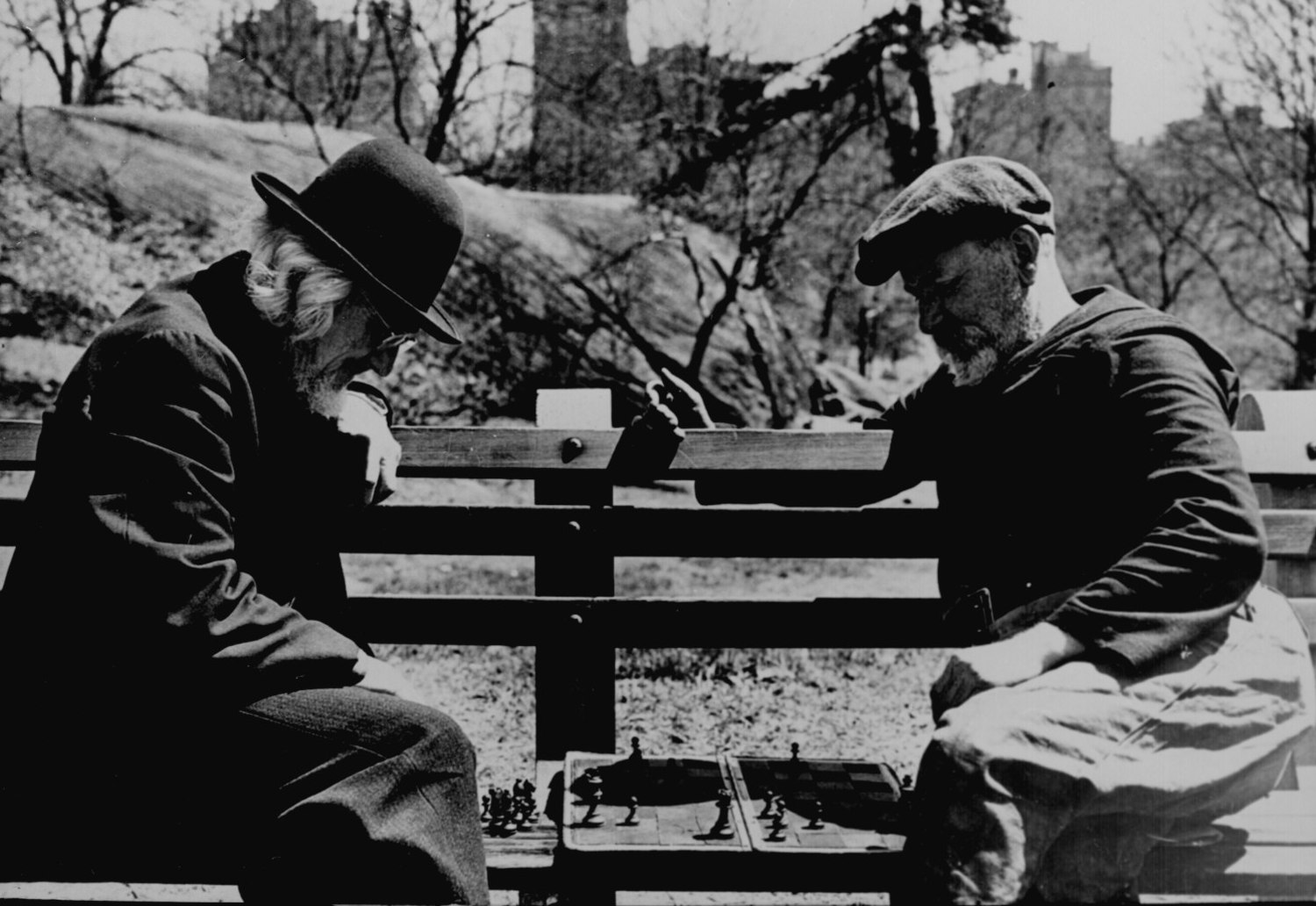 Two oldtimers playing chess on a Central Park bench in New York City, May 1946.