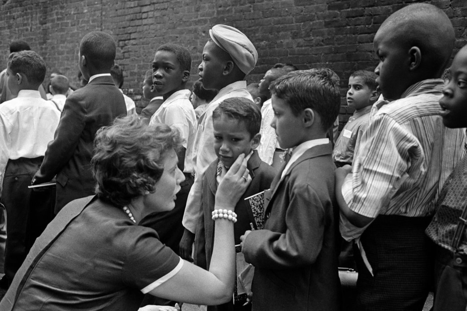 1960s - September 1961: A teacher, Sylvia Rahm, comforts a new student at Public School 145, on 105th Street between Columbus and Amsterdam Avenues.