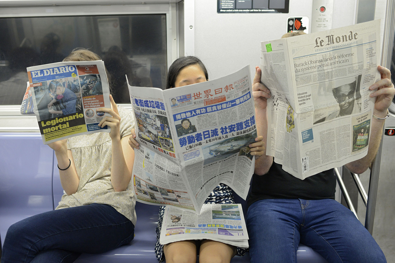 "People on Subway Reading Spanish, Chinese and French Newspapers | You can use this photo for non-commercial purposes if you give credit, under this <a href=""https://creativecommons.org/licenses/by-nc/3.0/us/"" rel=""nofollow"">Creative Commons license</a>. For-profit media organizations also may use this, but as editorial content only (as illustrations for stories, for example, but not as advertising). Credit must read: Richard Yeh / WNYC  We'd love to know if you're using this photo - send us an email (jkeefe@wnyc.org)!"