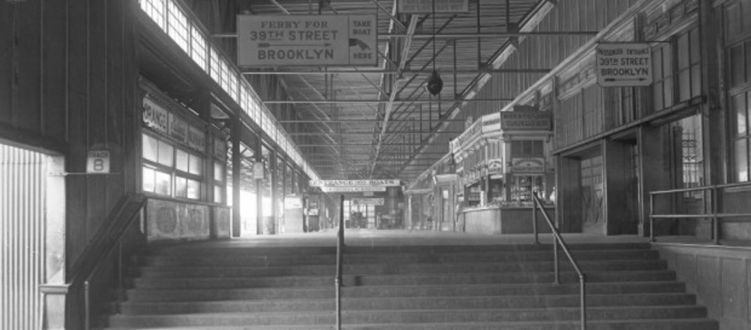 The interior of the St. George Terminal showing the entrance to the Brooklyn Ferry, circa 1927.