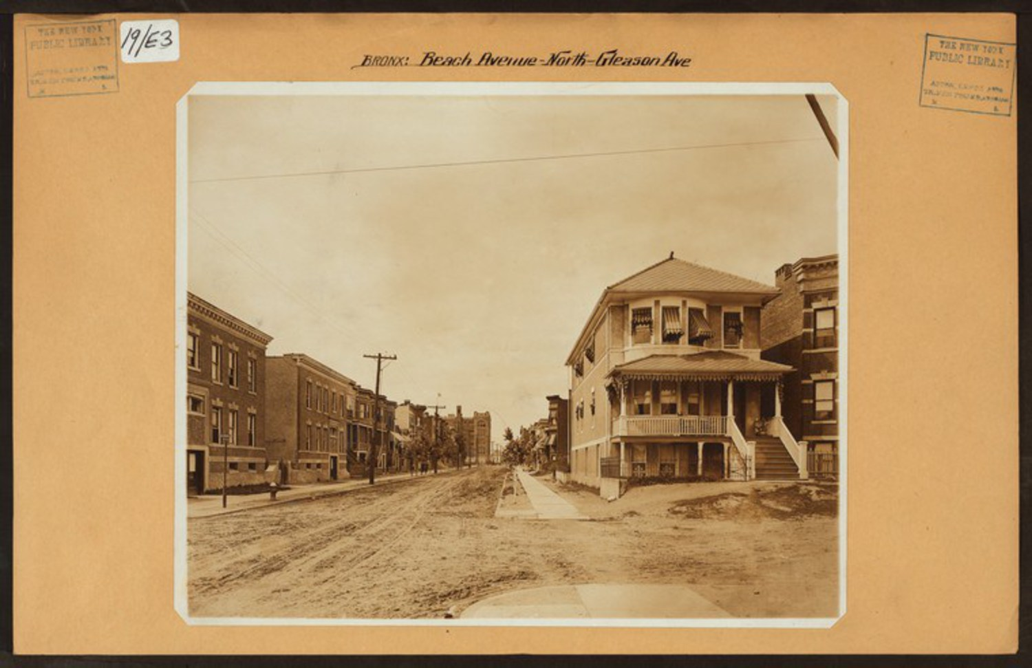 "Beach Avenue looking north at Gleason Avenue in Soundview in 1915. At the end of the street you can see PS 47 which still stands but today would barely be visible from this same vantage point as the 6 train obscures the view. Image Credit: Irma and Paul Milstein Division of United States History, Local History and Genealogy, The New York Public Library. ""Bronx: Beach Avenue – Gleason Avenue"" The New York Public Library Digital Collections. 1915."