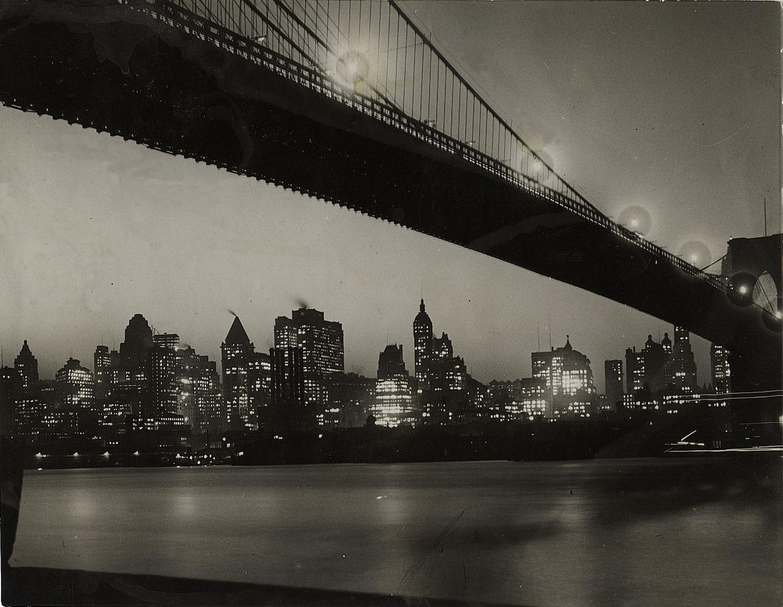 Manhattan skyline at night under Brooklyn Bridge, 1928