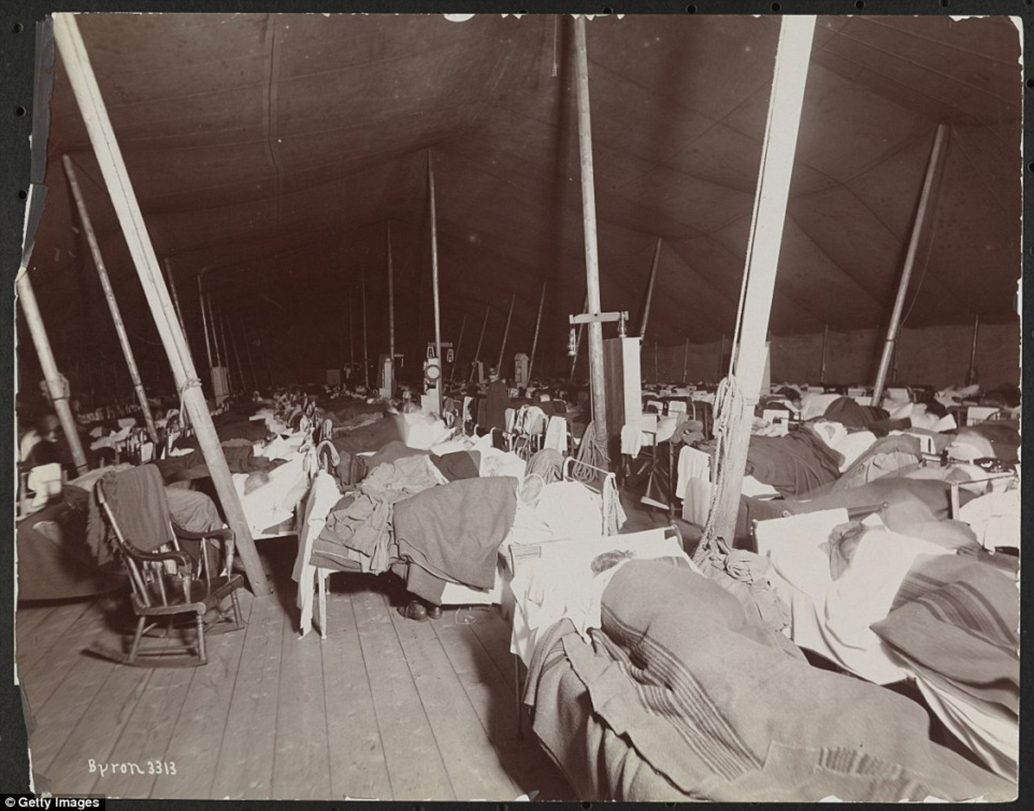 Patients sleeping on beds in a large tent on what was then known as Welfare Island in the mid-1890s. The city's prison was later relocated to Riker's Island, where it remains to this day