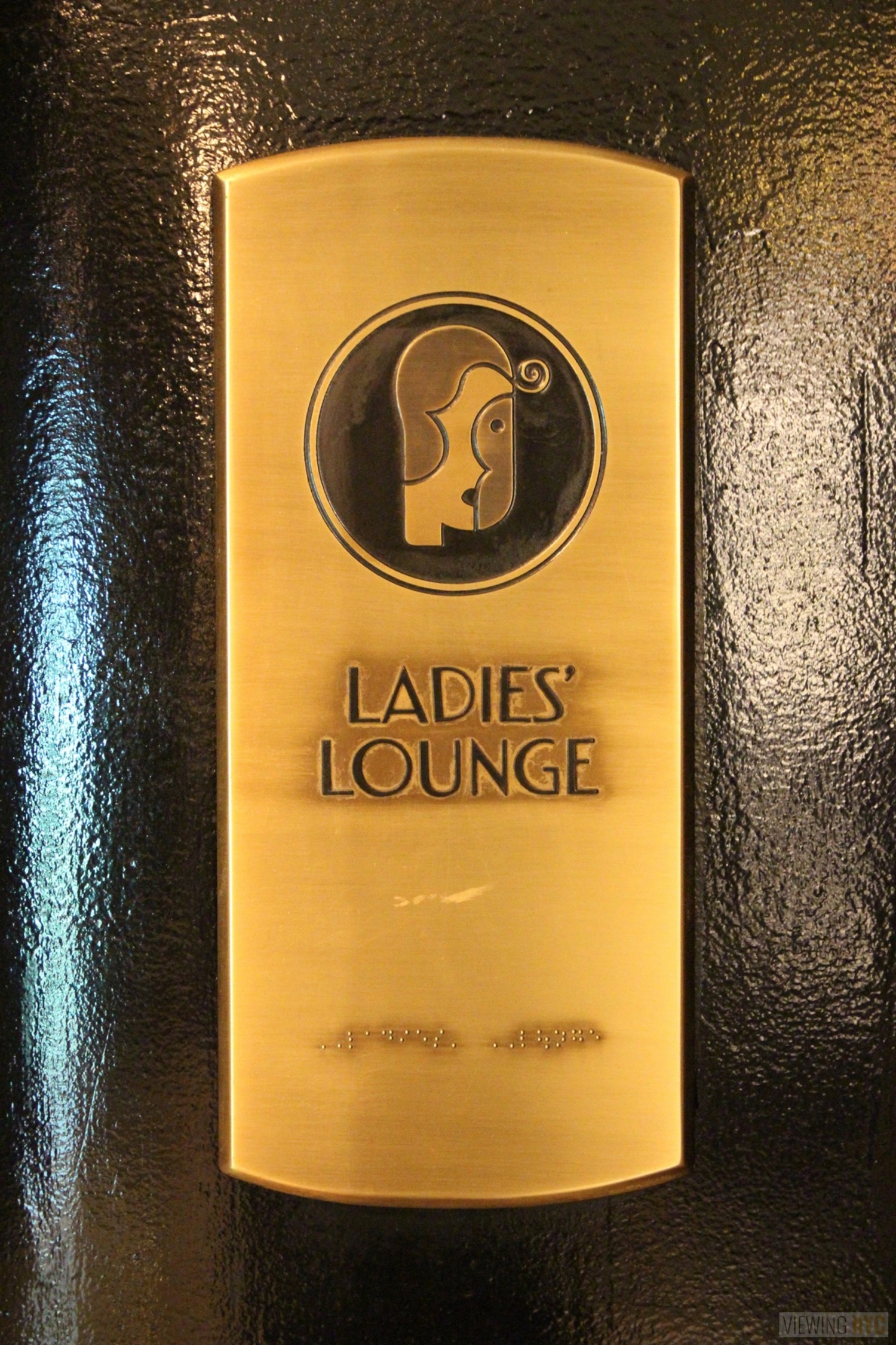 "Ladies Lounge Brass Plate | Built in 1932, Radio City Music Hall is a prime example of art deco architectural style that has withstood the test of time. With tons of gold, reflective surfaces and geometric design, walking through the venue is a bit like stepping back in time. Most of the fixtures, furniture and ornamentation are original, and any replacements are exact replicas of how the theater looked 80 years ago.  Read more here: <a href=""https://viewing.nyc/i-braved-a-walkthrough-of-radio-city-music-hall-meant-for-tourists/"" rel=""nofollow"">viewing.nyc/i-braved-a-walkthrough-of-radio-city-music-ha...</a>"
