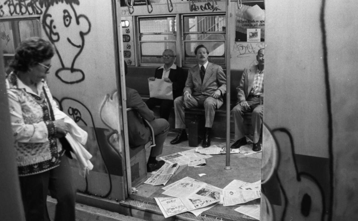 1970's: Despite the more than 40 percent increase in subway fare, this 1975 subway car is still covered in graffiti and littered with trash.