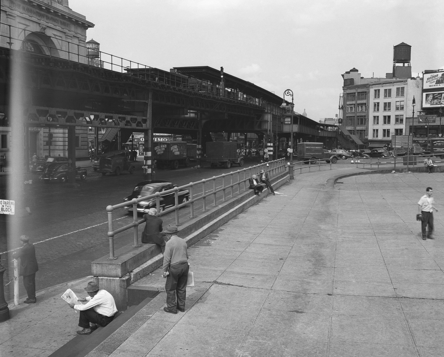The photo shows the Bowery where it intersects with Canal Street in New York, 1947. The Third Avenue El, or, Elevated, train is on the left.