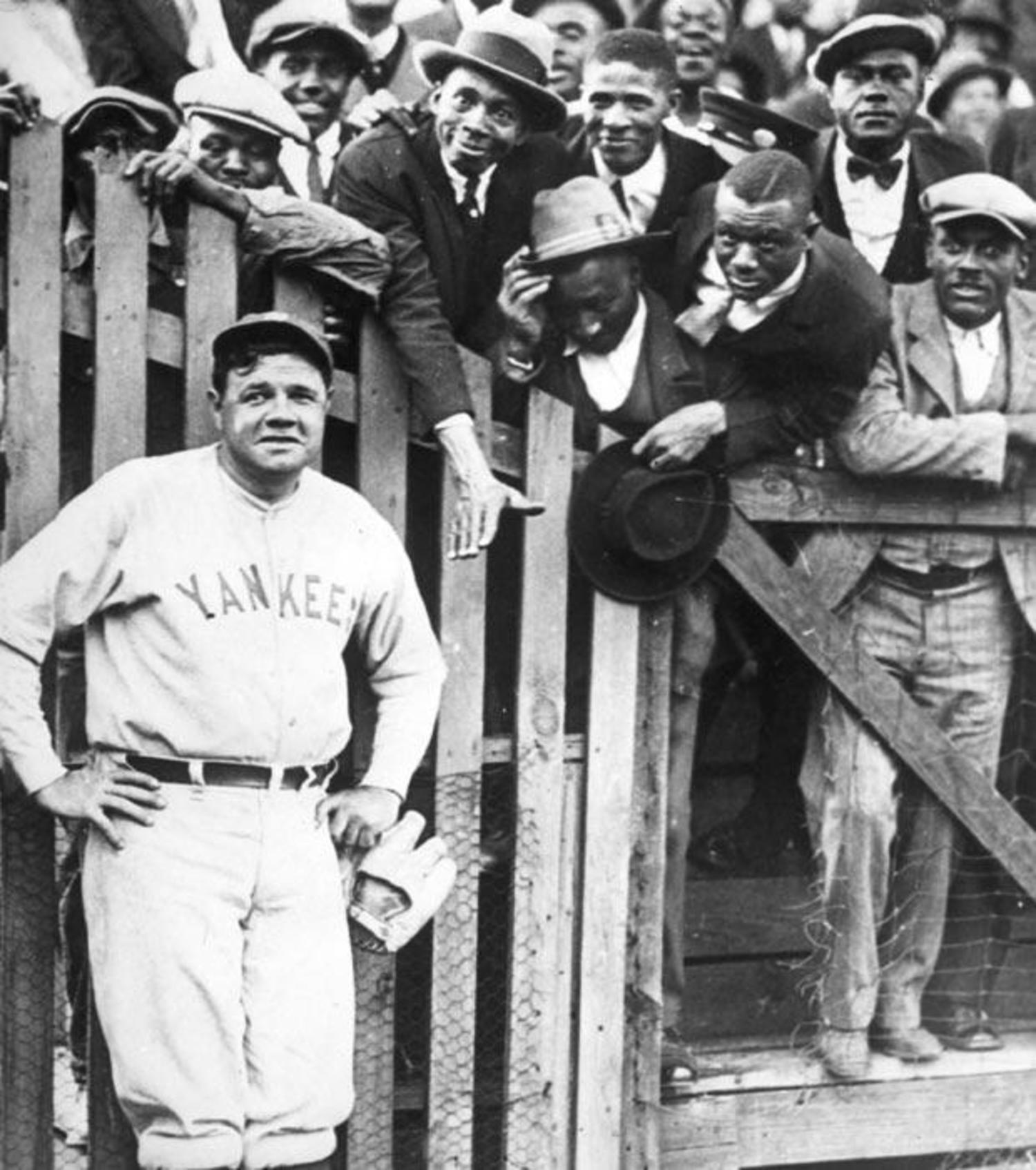 Babe Ruth posing with fans 1925.