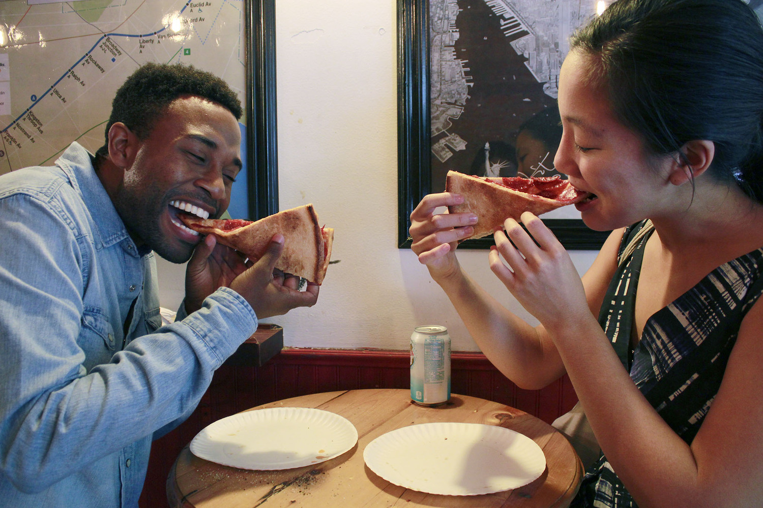 "Man and Woman Eating Folded Slices of Pizza and Smiling | You can use this photo for non-commercial purposes if you give credit, under this <a href=""https://creativecommons.org/licenses/by-nc/3.0/us/"" rel=""nofollow"">Creative Commons license</a>. For-profit media organizations also may use this, but as editorial content only (as illustrations for stories, for example, but not as advertising). Credit must read: Louise Ma / WNYC  We'd love to know if you're using this photo - send us an email (jkeefe@wnyc.org)!"