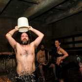 David Abrams cooling off with ice water in a sauna at the Russian and Turkish Baths.