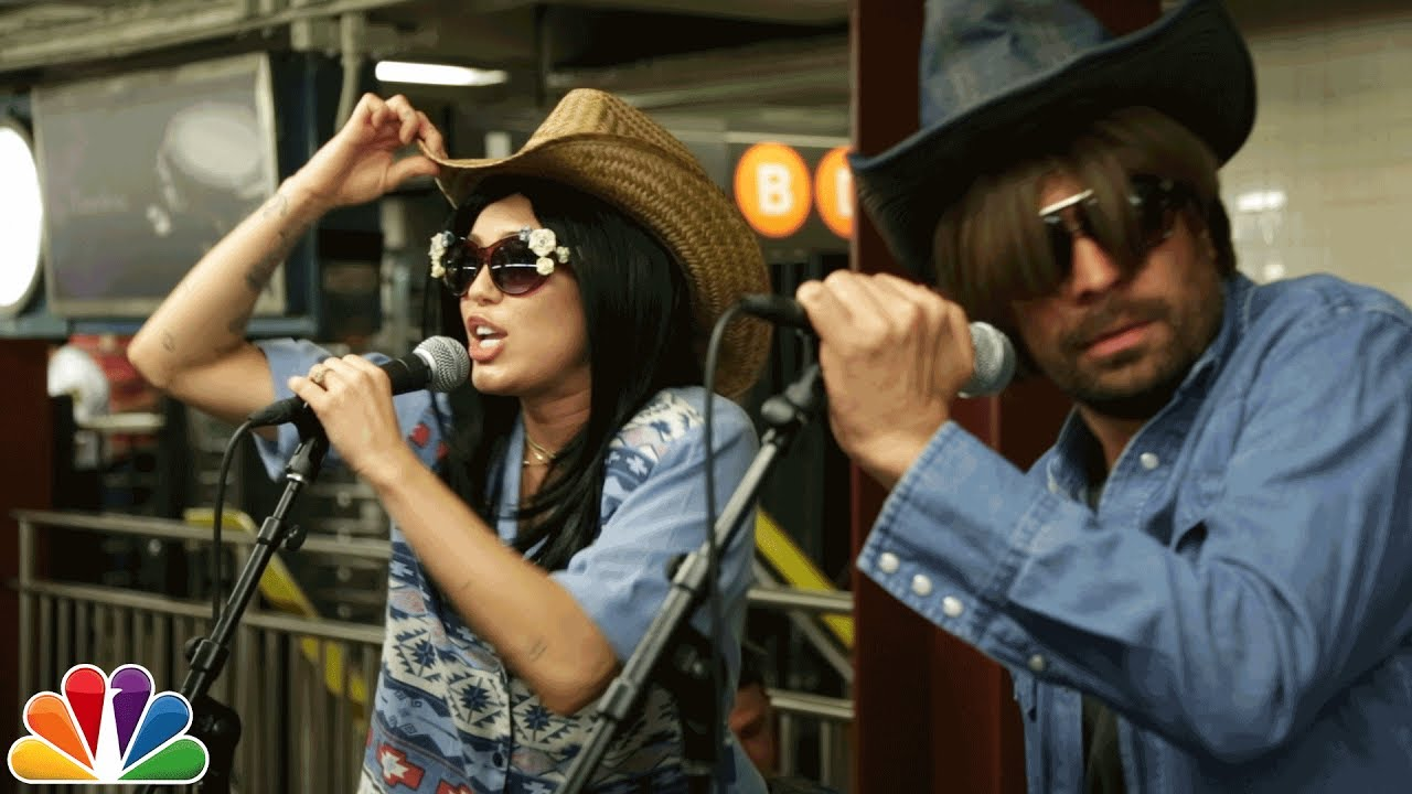 Watch Miley Cyrus And Jimmy Fallon Busk In Disguises On A