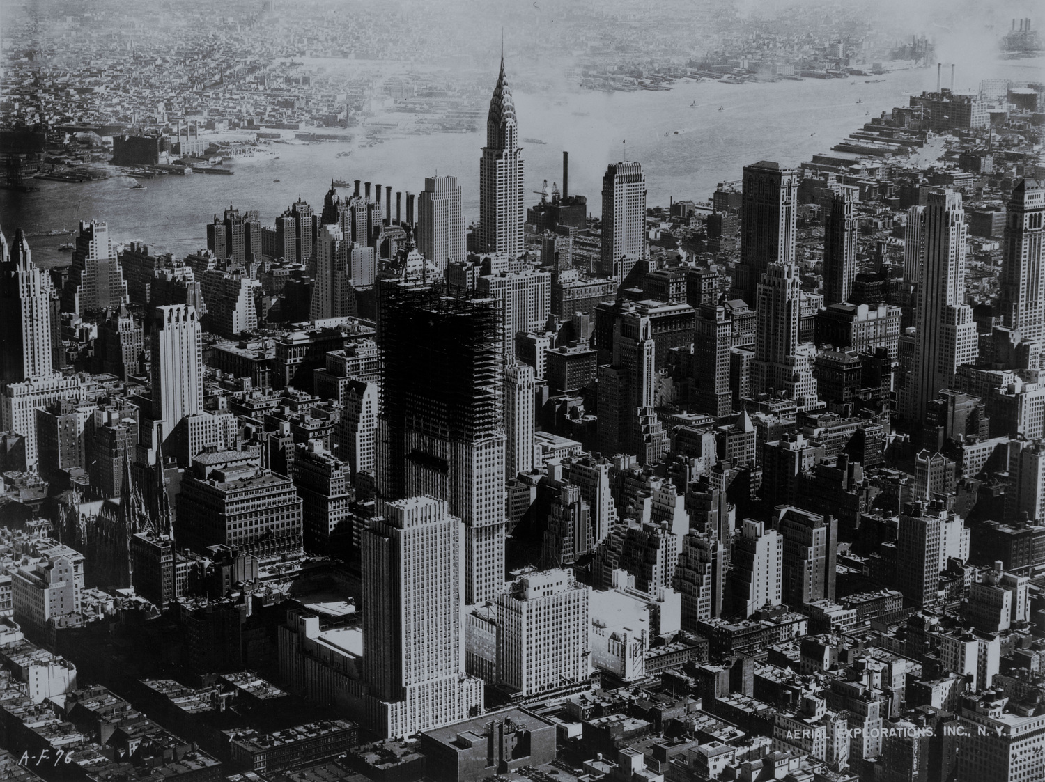 "Rockefeller Center under construction, New York City, 1932 | Rockefeller Center rises in mid-Manhattan. Photograph by Hamilton M. Wright for Aerial Explorations, Inc., N.Y., 1932.  From the New York World-Telegram Collection at the <a href=""http://memory.loc.gov/ammem/index.html"" rel=""nofollow"">U.S. Library of Congress</a>. <a href=""http://flickr.com/search/?q=world-telegram&m=tags&w=76204898@N00&s=int"">More pictures from the World-Telegram Collection</a> <b>[PD]</b> <a href=""http://hdl.loc.gov/loc.pnp/cph.3c36071"" rel=""nofollow"">This picture</a> is assumed to be in the public domain."