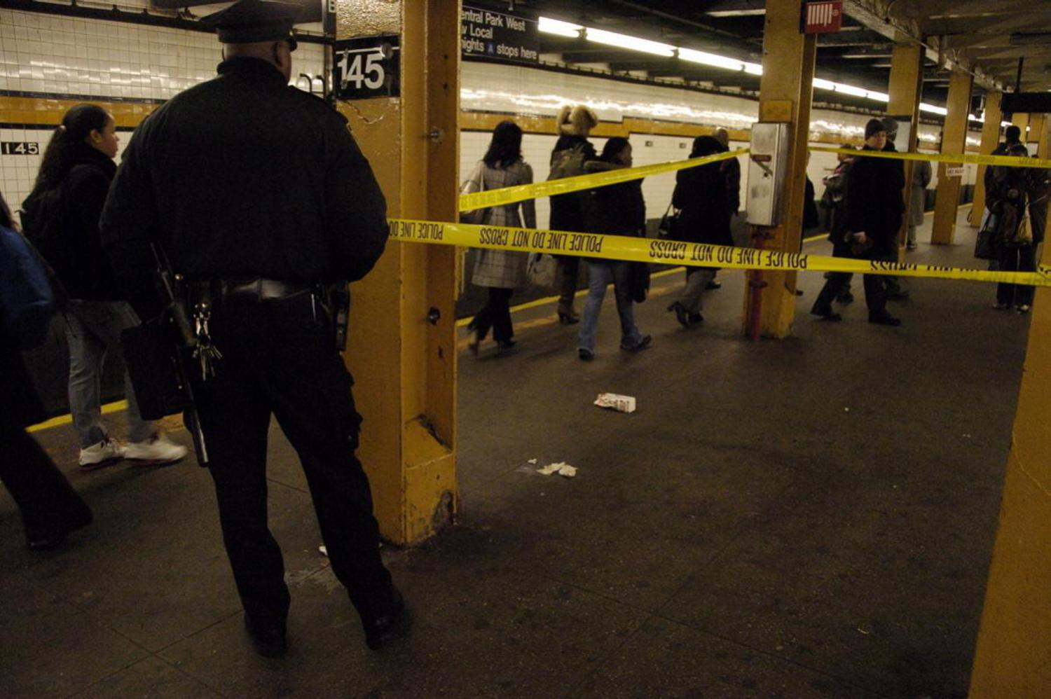 2000's: A 14-year-old boy was reportedly on his way to school when he was stabbed at the subway station at West 145th St. and St. Nicholas Avenue in 2007. Police tape cordons off the scene, pictured here.