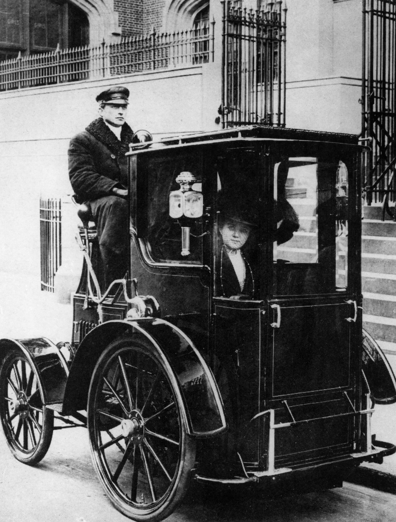 Woman passenger in a 1910 taxi cab, New York.