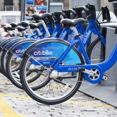 Citi bikes lined up at the Brooklyn Navy Yard | Citi bikes lined up at The Brooklyn Navy Yard a modern industrial park in a historical setting. With tenants representing a variety of industries like construction, theatrical set design, computer and office supplies, contracting, refrigerated distribution facilities, media communications and promotions, motor overhauling, and metal fabrication, the Navy Yard is capable of handling any type of business with a planned Multi-story Green Industrial Facility and New Green Manufacturing Plant.