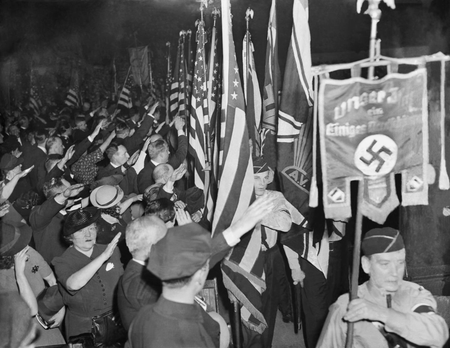 Supporters salute the banner of the German American Bund.