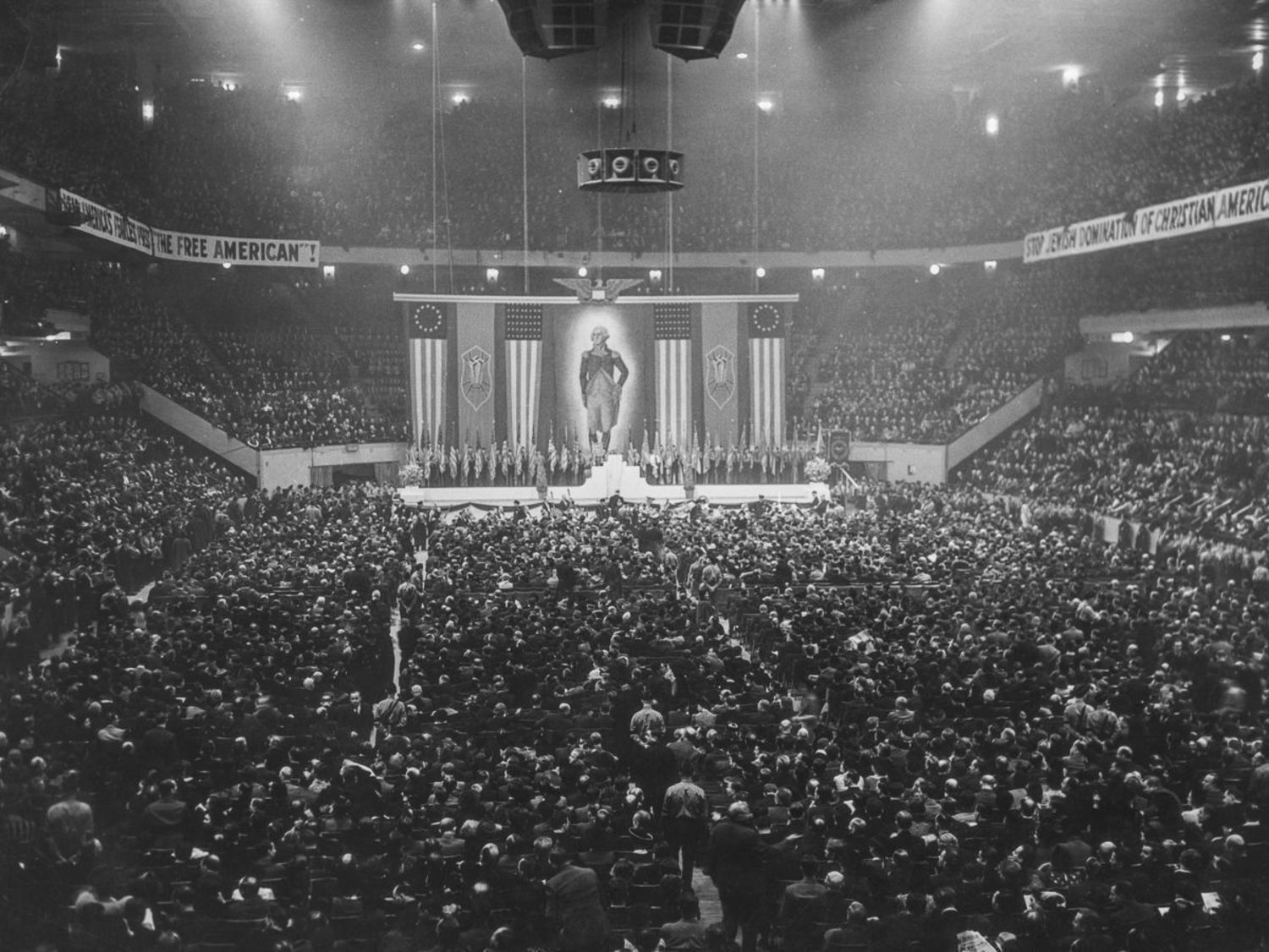 """Feb. 20, 1939. Twenty-thousand attend a meeting of the German American Bund, which included banners such as """"Stop Jewish Domination of Christian Americans."""""""