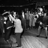 People dance a final impromptu jitterbug session at the Savoy Ballroom in the Harlem section of New York before the close of the landmark dance hall on Oct. 3, 1958.