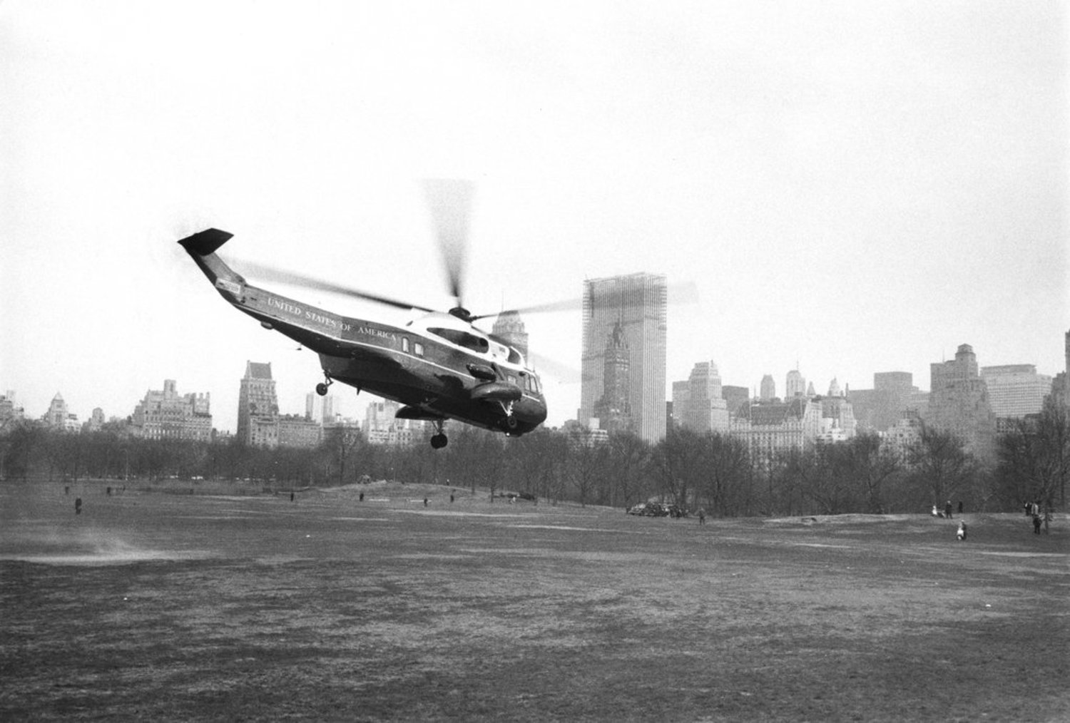 "April 4, 1968: The presidential helicopter left Sheep Meadow in Central Park after a sudden surprise visit to attend the ceremonies installing Archbishop Terence J. Cooke at St. Patrick's Cathedral. ""Until last week,"" said one girl in the crowd watching across the street from the cathedral, ""I would have booed the President. But I'm confused about what's happened in the last few days. I don't know what it all means."" Presumably, she was referring to President Johnson's recent decision not to run to retain office. Later that night, Martin Luther King Jr. was assassinated."""