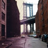 A view of the Manhattan Bridge from Brooklyn, with the view from 1970 on the left and today's view on the right.
