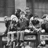 "Nov. 27, 1969: Youngsters found a good spot to view the Macy's Thanksgiving Day Parade, from atop a telephone booth. ""It was a day of abundance, not only of foods and goods, but of emotions also,"" reported The Times. ""Five raggedy children entered the Salvation Army cafeteria at 535 West 48th Street and, sitting among the weary old men and women who traditionally feast with the army on this holiday, received heaps of turkey and potatoes, peas and pumpkin pie."" Elsewhere, some G.I.s boycotted turkey dinner, to protest the American war in Vietnam, as did the Vegetarian Society of New York, to protest the exploitation of animals."
