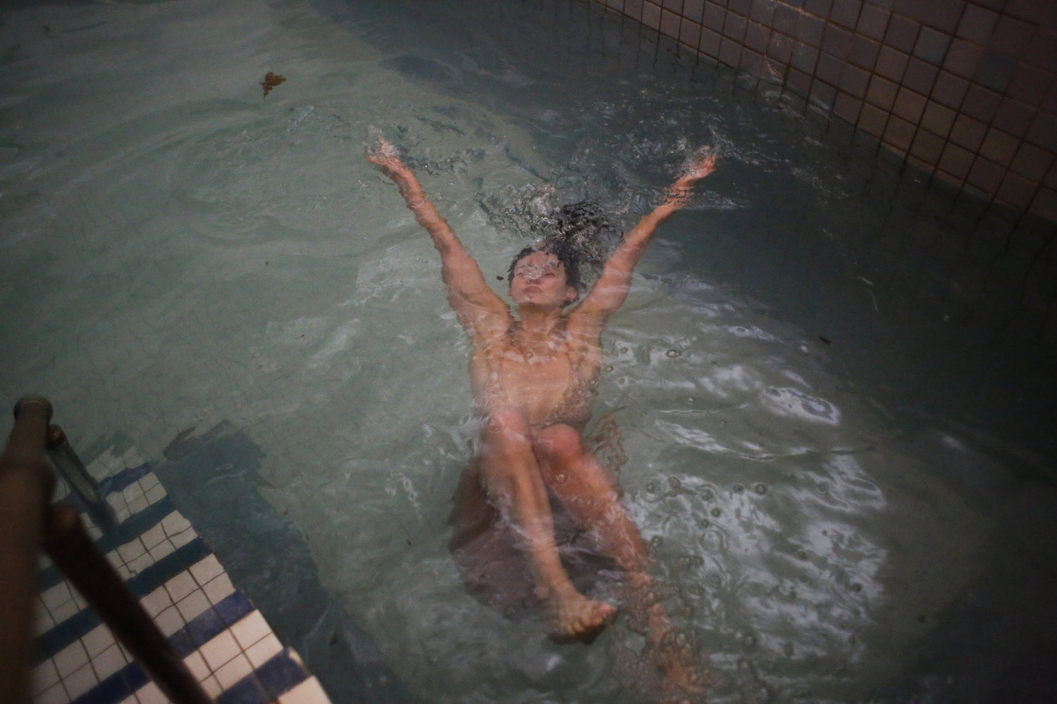 Vanessa Luczun takes a dip in the 45-degree pool in the center of the bathhouse after heating up in the saunas.
