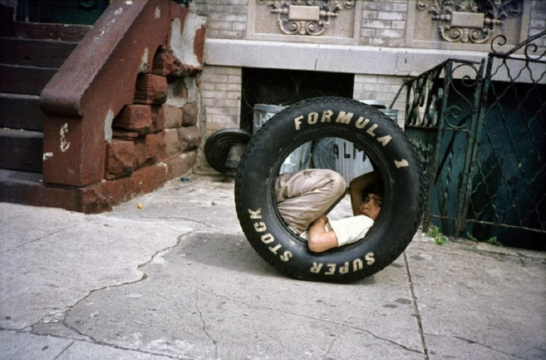 Boy in a Tire, Bushwick, Brooklyn, NY, 1984.