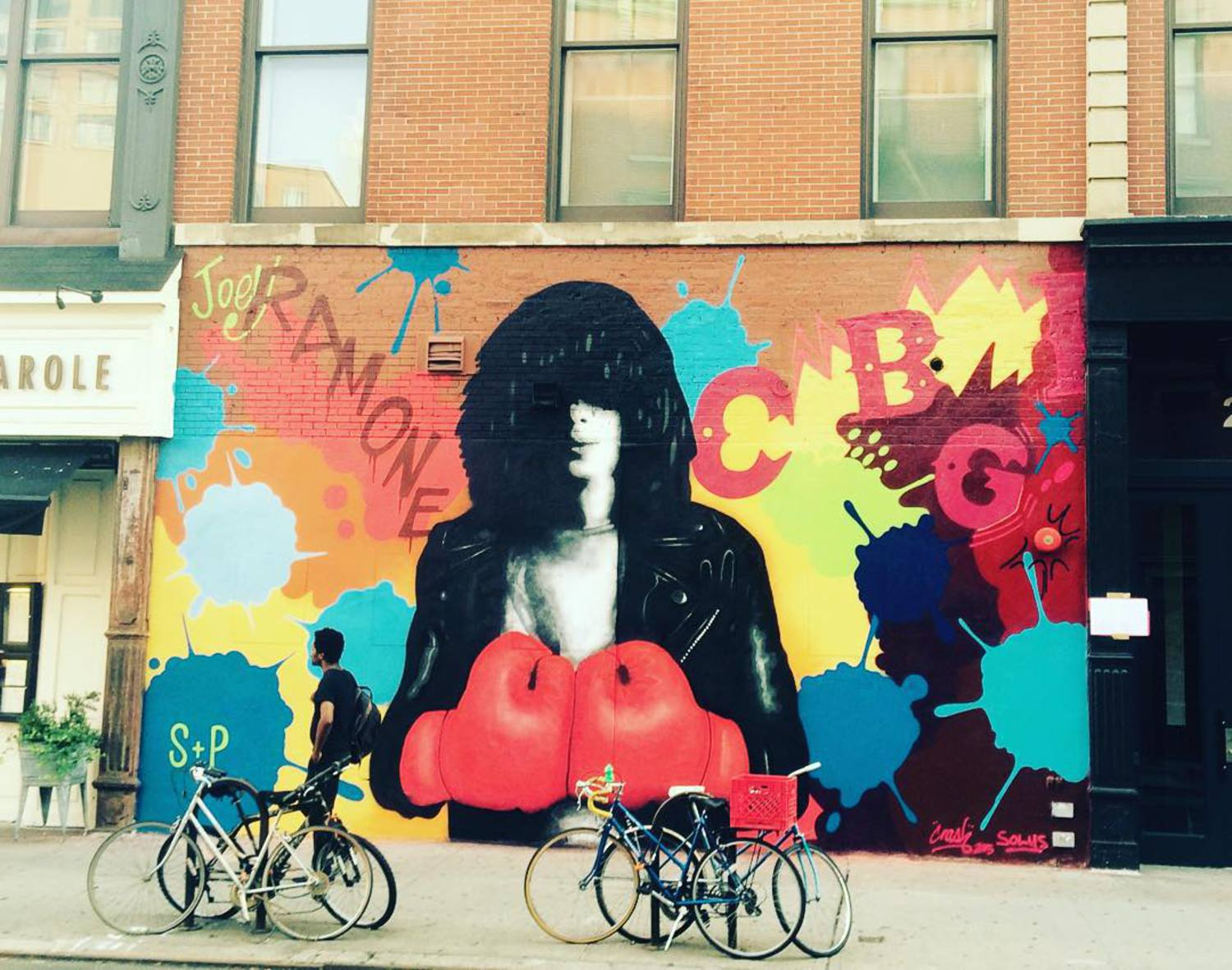 Completed @ramones mural right across from former CBGB's on Bowery and Bleecker painted with @crashone the gloves represent the struggle Joey and the ramones endured to achieve success they performed 2,263 times virtually touring non-stop for 22 years . Mural organised by  @thelisaprojectnyc @lomanartfest #joeyramone #solus #crashone #lisaproject