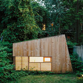 "Architect Nicholas Hunt used his garden as a laboratory for his budding private practice, creating a 55-square-foot studio filled with handcrafted details, including a half-inch reveal surrounding the front window and a Plexiglas skylight. ""When a place is this small, the minimal details need to be nice,"" Hunt says."