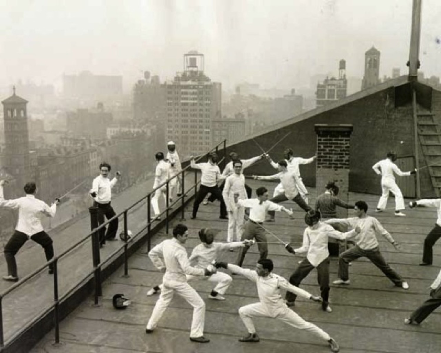 Uncategorized Old Fencing check out this vintage photograph of nyu students fencing on the practice roof one university buildings january 1929
