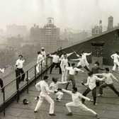 Fencing practice on the roof of one of the University buildings, January 1929