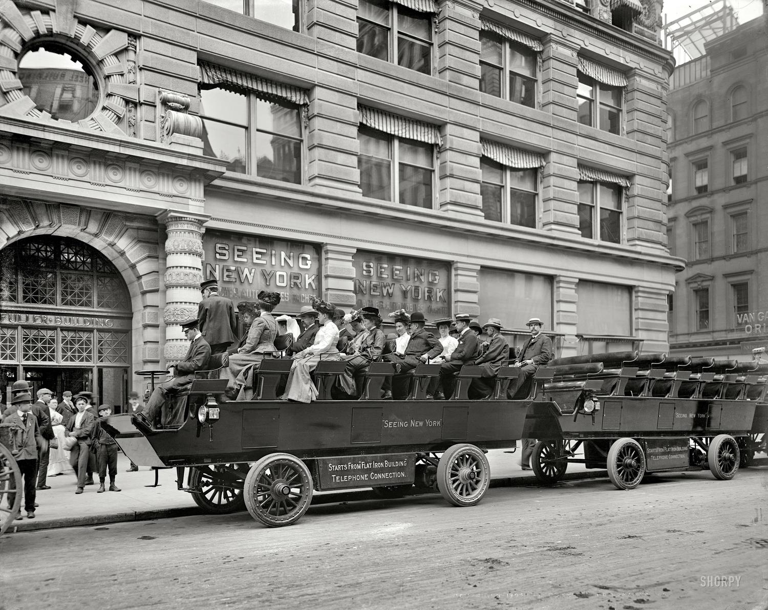 """""""Seeing New York"""" — Electric omnibuses at the Flatiron Building, c. 1904"""