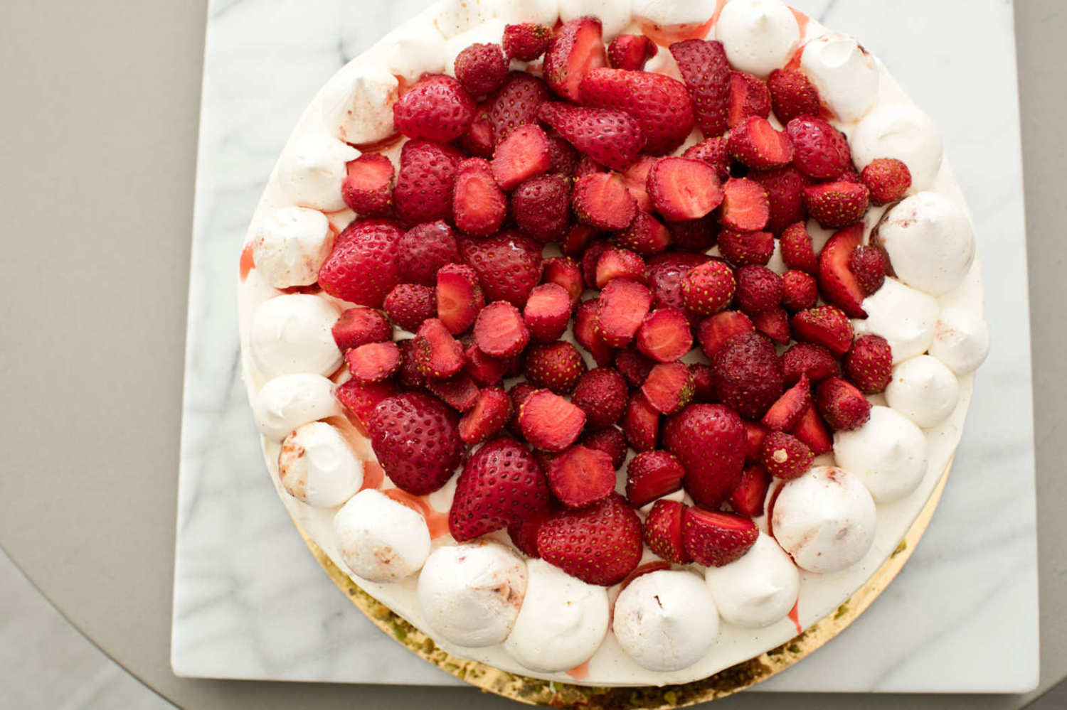 Vanilla cake with layers of Chiboust pastry cream, macerated strawberries, and crushed and whole strawberry-scented meringue.