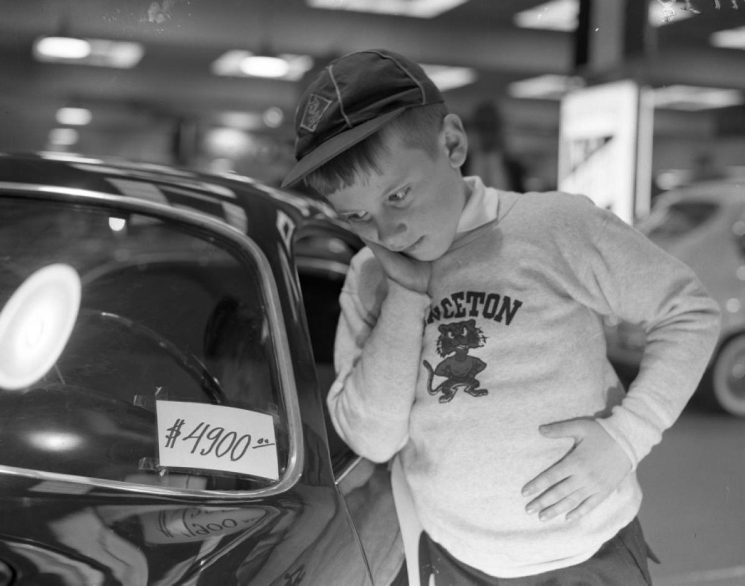 """Ralph Hubbard, 8, is thinking how nice it would be if pop could ante up $4,900 for Italian car [sic] being displayed at the Coliseum yesterday"" – read the Daily News' original caption. Ralph, we're hoping to finally got that dream car you wanted at the New York Auto Show."