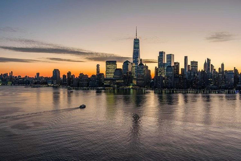 Sunset over New York Harbor and Lower Manhattan Skyline