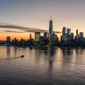 Sunset over New York Harbor and Lower Manhattan Skyline
