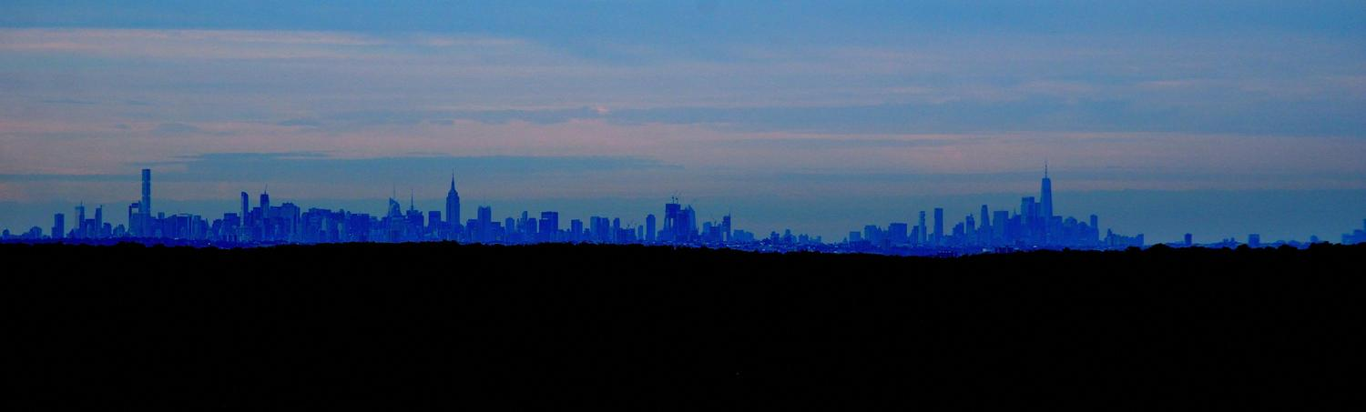 Mountain view of the city from 28.57 miles away