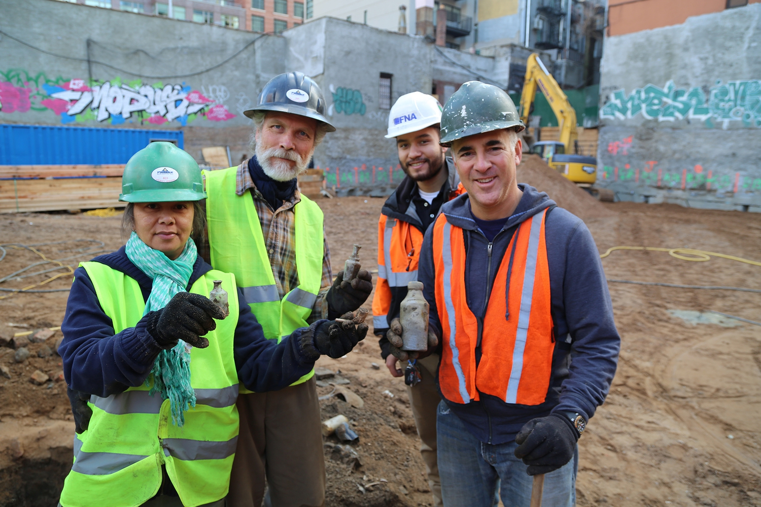 Scott Jordan, second from left, and Bob Perl, far right, at the dig site, with Jordan's assistant, far left, and the construction-site foreman, second from right.