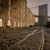 Abandoned railroad tracks dart along the cobblestones of the Brooklyn waterfront, by Walker Evans 1960