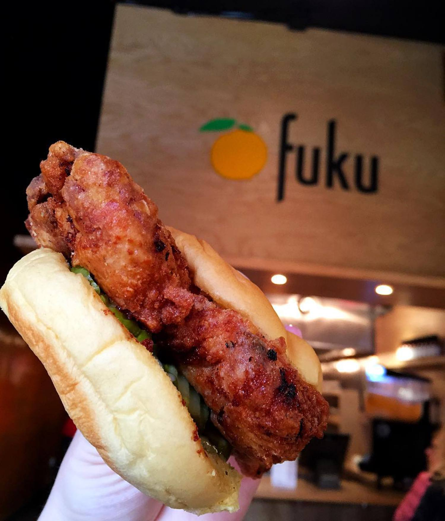 The best spicy fried chicken sandwich in NYC - coated with habanero and topped with pickles & Fuku's famous Ssäm sauce 😋