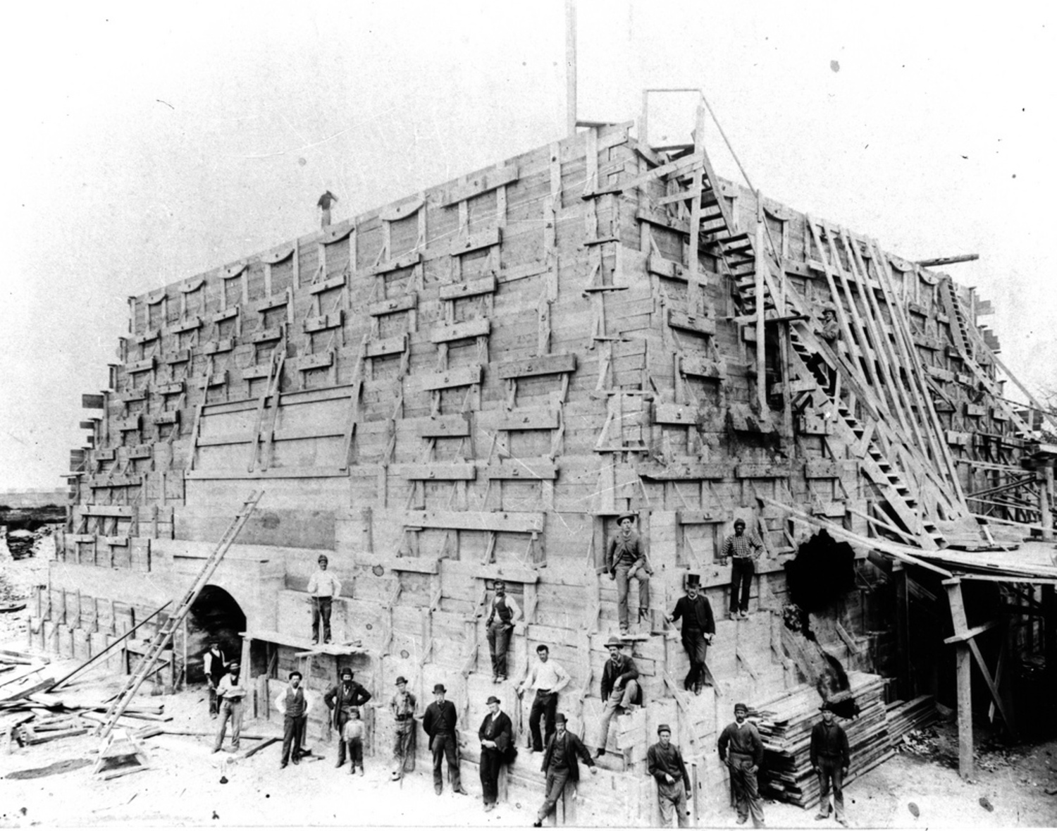 Workers at the monument's base, 1884. The United States was responsible for building and funding the pedestal, which stands at 154 feet, just a few feet taller than the statue.