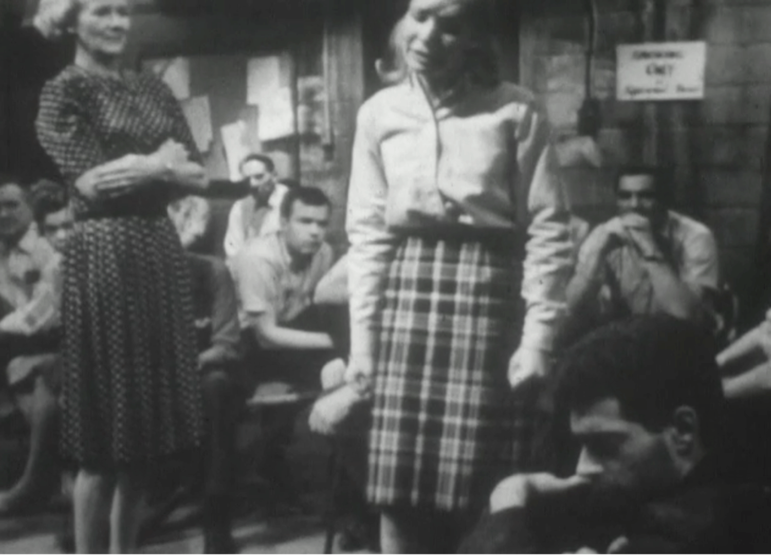 A still from the 1964 government produced film, Public Shelter Living: The Story of Shelter 104, which dramatized fallout shelter living.