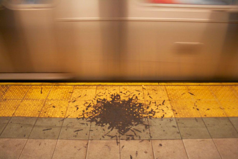 Undisturbed pile of gunk on a NYC subway platform.