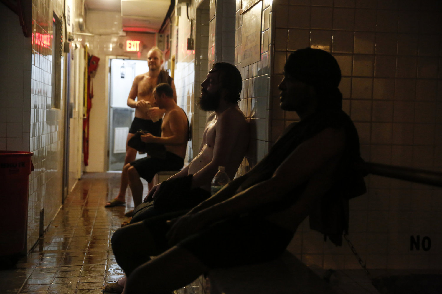 Visitors relax in the common area between saunas, steam rooms and an ice-cold pool in the East Village bathhouse.